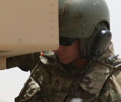 Staff Sgt. Brian Lang, a High Mobility Artillery Rocket System crew chief for Bravo Battery, 1st Battalion, 14th Field Artillery Regiment, 65th Field Artillery Brigade, Task Force Spartan, works the controls on his HIMARS during exercise Golden Sparrow on June 29, 2018. Lang and other Soldiers from Bravo Battery recently rotated back to UAE after supporting missions in Afghanistan.