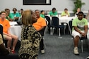 Tawana Williams, motivational speaker, talks with Airmen and youth from Mount Pleasant M.B. Church about her life and how she overcame life with a disability July 16, 2018, at Columbus Air Force Base, Mississippi. Williams was born without arms and wasn't supposed to live longer than two years old. (U.S. Air Force Photo by Airman 1st Class Beaux Hebert)