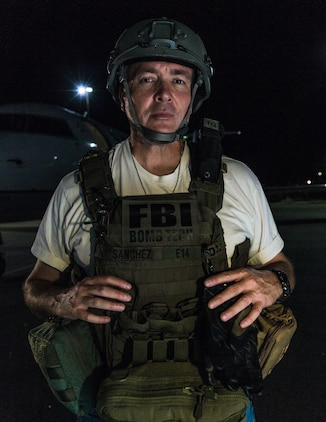 Rick Sanchez, special agent bomb technician, Federal Bureau of Investigation, gears up for Operation Bono at Palm Springs International Airport, Palm Springs, Calif., July 13, 2018. The purpose of Operation Bono is to provide unique training opportunities for federal, state, and local public safety bomb squads and military explosive ordnance disposal teams, as well as facilitates training and drills designed for bomb squads to employ their tactics while operating in the aviation domain in, and around PSP airport. (U.S. Marine Corps photo by Lance Cpl. Rachel K. Porter)