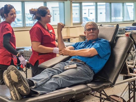 Paul Salkowski, 934th Communications Squadron, donates blood at the 934 AW blood drive July 18.  More donations are needed and the drives are held quarterly with the next drive scheduled for  Oct. 3. (Air Force Photo/Paul Zadach)