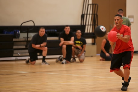 A Marine blocks a dodgeball during a tournament for the Semper Fit Summer Challenge aboard Marine Corps Air Station Beaufort July 18. The Summer Challenge is a program that promotes a healthy, active lifestyle and builds unit cohesion.