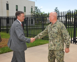 Adm. Kurt W. Tidd, commander of U.S. Southern Command, greets USAID Administrator Mark Green