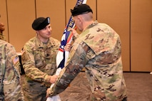 Lt. Col. Kenneth Lutz, 6th Medical Recruiting Battalion incoming commander, presents the battalion colors to Command Sgt. Maj. James E. Stevens, during the 6th MRBn Change of Command Ceremony on July 19.
