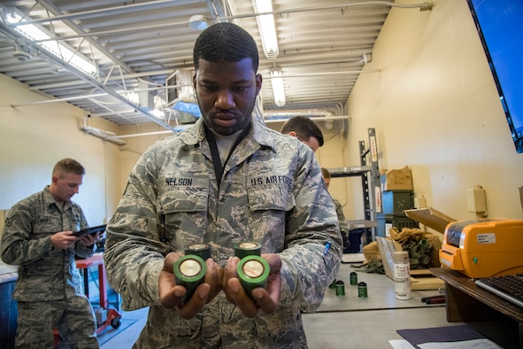 Senior Airman Travis Nelson, 23d Maintenance Squadron (MXS) munitions inspector, examines 40mm projectile explosive shells, July 10, 2018, at Moody Air Force Base, Ga. Munitions inspectors enhance Moody's combat capabilities by inspecting and approving safe and serviceable ammo. (U.S. Air Force photo by Airman 1st Class Eugene Oliver)