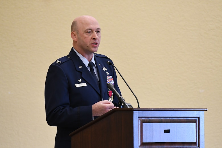 U.S. Air Force Col. Danny Davis, outgoing 81st Mission Support Group commander, delivers remarks during the 81st MSG change of command ceremony in the Bay Breeze Event Center at Keesler Air Force Base, Mississippi, July 19, 2018. Davis relinquished command of the 81st MSG and will be assigned to 2nd Air Force until he retires in September 2018, with more than 24 years of military service. (U.S. Air Force photo by Kemberly Groue)