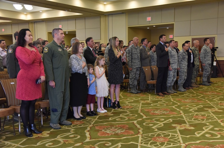 Keesler personnel, families and friends attend the 81st Mission Support Group change of command ceremony in the Bay Breeze Event Center at Keesler Air Force Base, Mississippi, July 19, 2018. U.S. Air Force Col. Marcia Quigley, incoming 81st MSG commander, assumed command from Col. Danny Davis, outgoing 81st MSG commander, with the passing of the guidon. The passing of the guidon is a ceremonial symbol of exchanging command from one commander to another. (U.S. Air Force photo by Kemberly Groue)