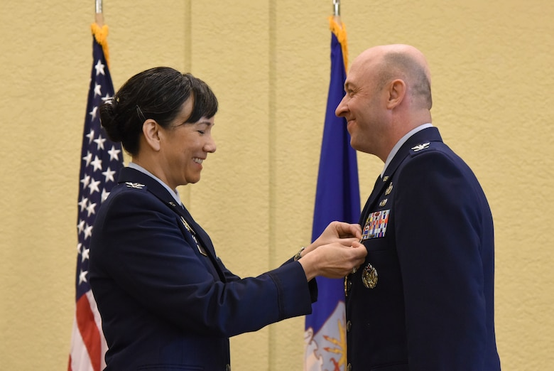 U.S. Air Force Col. Debra Lovette, 81st Training Wing commander, presents Col. Danny Davis, outgoing 81st Mission Support Group commander, with a Legion of Merit medal during the 81st MSG change of command ceremony in the Bay Breeze Event Center at Keesler Air Force Base, Mississippi, July 19, 2018. Davis relinquished command of the 81st MSG and will be assigned to 2nd Air Force until he retires in September 2018, with more than 24 years of military service. (U.S. Air Force photo by Kemberly Groue)