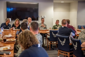 Cols. Joel Safranek, 436th Airlift Wing commander, and Craig Peters, 512th Airlift Wing commander, thank the honorary commanders during a luncheon at Dover Air Force Base, Del., July 19, 2018. Honorary commanders had lunch as they conversed with the wing commanders about Dover Air Force Base's mission during a round-table discussion. (U.S. Air Force photo by Staff Sgt. Damien Taylor)