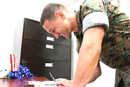 U.S. Marine Corps SSgt. James Ahearn stopped by the Marine Corps Logistics Base Albany Adjutant Office to learn information about how to cast his ballot three months before the general election in Georgia. The Adjutant Office held the 2nd annual Voting Convention for Marines and civilian-Marines, July 19. The event is part of an annual training for all active duty personnel. (U. S. Marine Corps photo by Re-Essa Buckels)
