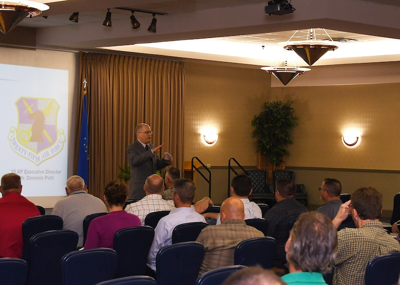 Dominic Pohl, 25th Air Force executive director, speaks at an all-call for base civilian employees July 19, 2018, on Grand Forks Air Force Base, North Dakota. Pohl's presentation was provided insight on what the 25th AF is and what its missions are across the Unites States. (U.S. Air Force photo by Airman 1st Class Elora J. Martinez)