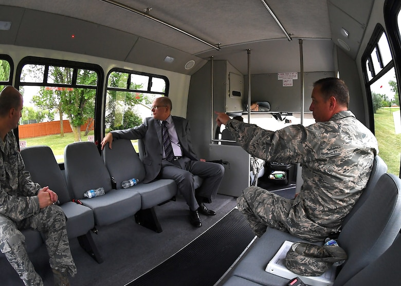 Dominic Pohl, 25th Air Force executive director, center, rides with Col. Benjamin Spencer, 319th Air Base Wing commander, right, and Col. Bart Yates, 319ABW vice commander, through base housing July 19, 2018, on Grand Forks Air Force Base, North Dakota. Pohl was interested in seeing the housing area in order to understand the quality of life for those who choose to live on base. (U.S. Air Force photo by Airman 1st Class Elora J. Martinez)