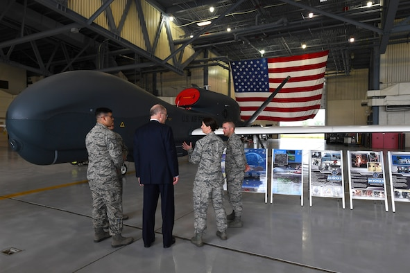 Dominic Pohl, 25th Air Force executive director, center, listens to Chief Master Sgt. Shannon Thomas, 69th Maintenance Group superintendent, center-right, explain the intelligence, surveillance and reconnaissance capabilities of the RQ-4 Global Hawk July 20, 2018, on Grand Forks Air Force Base, North Dakota. The 69 MXS mission plays a large role on Grand Forks AFB, operating Global Hawk missions year-round to offer ISR abilities worldwide. (U.S. Air Force photo by Airman 1st Class Elora J. Martinez)