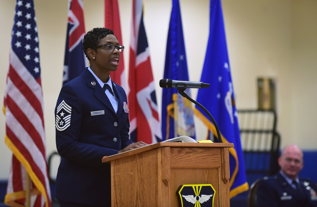 Chief Master Sgt. Tamar Dennis, 460th Space Wing command chief, addresses members of Team Buckley on the importance of striving for excellence during a change of responsibility ceremony on Buckley Air Force Base, Colorado, July 20, 2018.