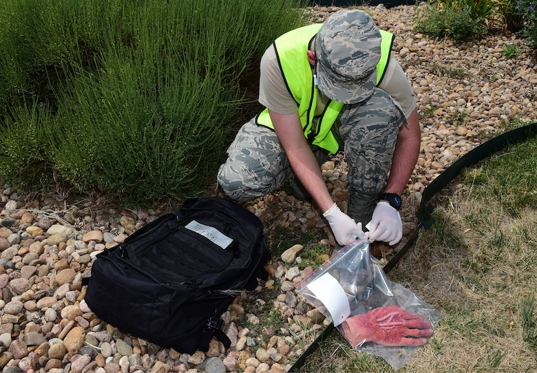 An Airman from the 460th Force Support Squadron simulates tagging a human hand as part of search and recovery training on July 19, 2018 on Buckley Air Force Base, Colorado. The training ensures Airmen are prepared for crisis response situations. (U.S. Air Force photo by Senior Airman AJ Duprey)