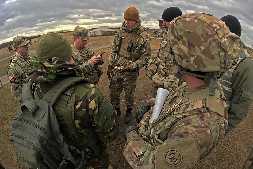 A group of soldiers have a discussion.