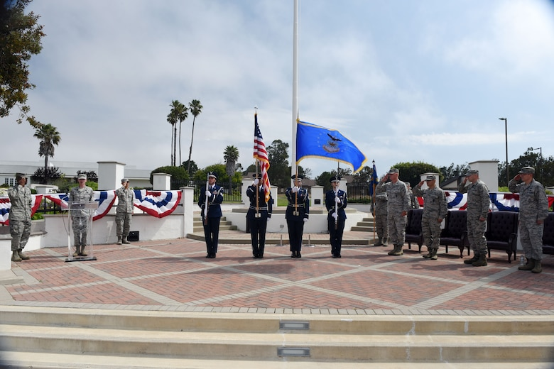 Vandenberg honor guardsmen present the colors during the 30th Launch Group deactivation ceremony on July 20, 2018, at Vandenberg Air Force Base, Calif. The 30th Space Wing inactivated the 30th LCG, merging their range responsibilities and personnel with the 30th OG. (U.S. Air Force photo by Tech. Sgt. Jim Araos/Released)