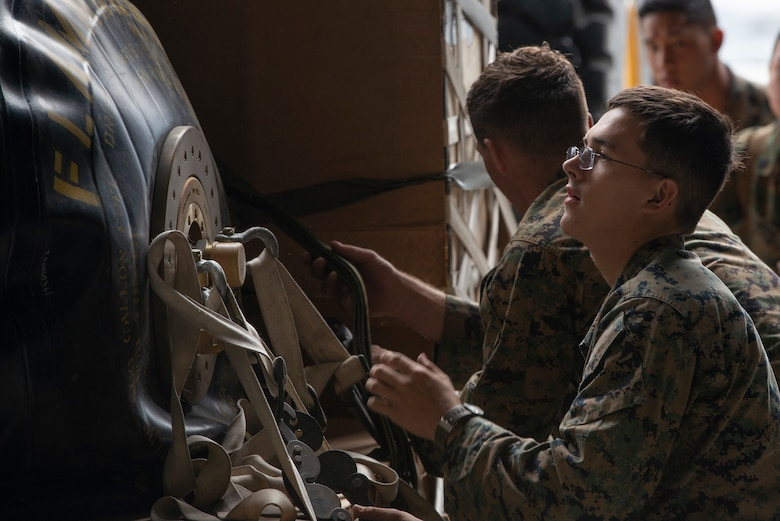 Marines of the 3d Transportation Support Battalion, VMGR-152, and Marine Wing Support Squadron 172 are participating in Exercise Kodiak Mace. During the exercise, through July 25, Marines are conducting joint precision air drop system, cargo, and personnel airdrops.