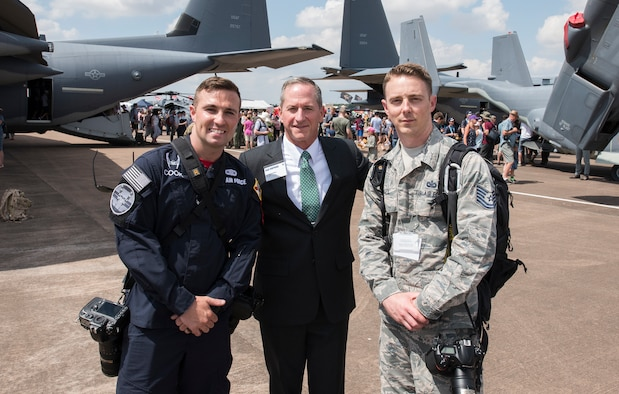 Airman 1st Class Alexander Cook, F-35 Heritage Flight Team public affairs, and Tech. Sgt. Brian Kimball, 501st Combat Support Wing photojournalist, pose for a photo with Chief of Staff of the Air Force, Gen. David Goldfein July 14, 2018 at Royal Air Force Fairford, England. As a member of F-35 HFT, Cook documents air shows around the world showcasing Air Force heritage.