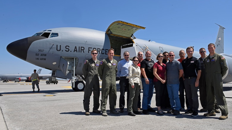 Four 93rd Air Refueling Squadron aircrew members and a group of Spokane-area school district superintendents pose for a photo after an orientation flight at Fairchild Air Force Base, Washington, July 18, 2018. As the Air Force enhances their partnerships with schools, educators gain more insight into Air Force opportunities and can enhance students' educational experiences. This partnership benefits recruiting while creating a more efficient way for Airmen and their families to address education concerns. (U.S. Air Force photo/Airman Jesenia Landaverde)