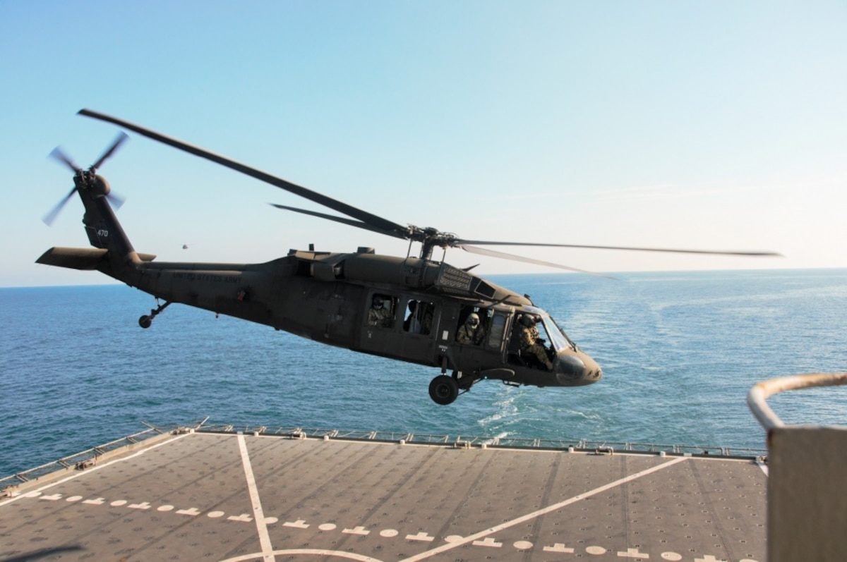 A UH-60 Black Hawk helicopter takes off after landing on the deck of the U.S. Navy Ship Alan Shepard in the Persian Gulf, Dec. 31, 2015.