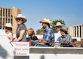 Col. Stacy Jo Huser, 90th Missile Wing commander, smiles/waves at the crowd during the 122nd Cheyenne Frontier Days opening Grand Parade in Cheyenne, Wyo., July 21, 2018. Air Force leadership is honored to participate in the parade to show their support to the community. The F.E. Warren Air Force Base and Cheyenne communities came together to celebrate the CFD rodeo and festival, which runs from July 20-29. (U.S. Air Force photo by Airman 1st Class Braydon Williams)