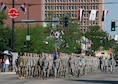 Airmen from F.E. Warren Air Force Base, Wyo., march in formation during the 122nd Cheyenne Frontier Days opening Grand Parade in Cheyenne, Wyo., July 21, 2018. Service members from multiple branches took part in the parade. This year marks the 151st anniversary of F.E. Warren Air Force Base and the city of Cheyenne. The F.E. Warren Air Force Base and Cheyenne communities came together to celebrate the CFD rodeo and festival, which runs from July 20-29. (U.S. Air Force photo by Tech Sgt. Christopher Ruano)