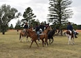 Members of a Buffalo soldier's re-enactment riding team perform during Fort D.A. Russell Days on F.E. Warren Air Force Base, Wyo., July 21, 2018. The performance is a demonstration of historical cavalry precision riding drills. The annual open house invites the community and visitors to tour the base to learn about its history and its current ICBM deterrence mission. (U.S. Air Force photo by Airman 1st Class Braydon Williams)