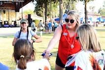 Incirlik Air Base USO members and U.S. Air Force volunteers hand out USO merchandise during the 4th of July celebration at Incirlik Air Base, Turkey, July 4, 2018.