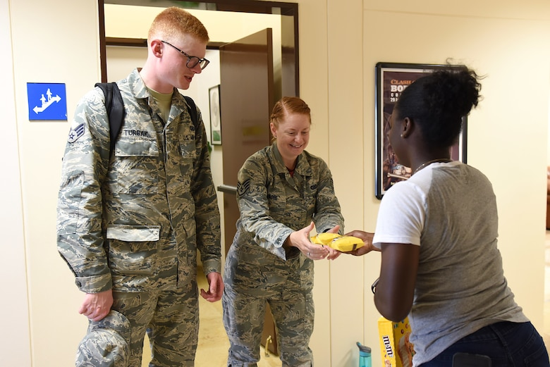 U.S. Air Force Airman 1st Class Valtrice Sullivan, 39th Security Forces Squadron contingency deployer and USO volunteer, hands out ice cream to Airmen at Incirlik Air Base, Turkey, July 13, 2018.