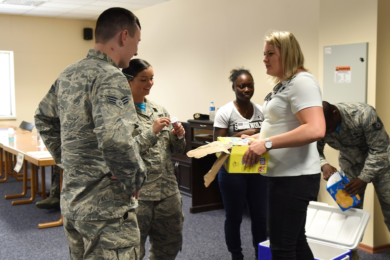USO volunteer Lisa Wease and U.S. Air Force Airman 1st Class Valtrice Sullivan  hand out ice cream at Incirlik Air Base, Turkey, July 13, 2018.