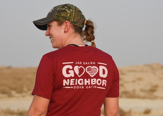 Staff Sgt. Brittani McClure, president of Jar Saleh, a volunteer organization at Al Udeid Air Base, waits for other volunteers during a trip to clean up beaches in Doha, Qatar, July 6, 2018. Jar Saleh works alongside the host nation's community groups to continue a good-faith relationship through acts of kindness and generosity. (U.S. Air Force photo by Staff Sgt. Enjoli Saunders)