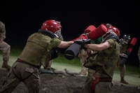 U.S. Marine Corps recruits of Echo Company, 2nd Battalion, Recruit Training Regiment, fight with pugil sticks during the Crucible July 20, 2018, on Parris Island, S.C. This training is part of the Marine Corps Martial Arts Program, which helps to create the warrior ethos by utilizing armed and unarmed techniques from various styles of martial arts. Echo Company is scheduled to graduate Aug. 3, 2018. Parris Island has been the site of Marine Corps recruit training since Nov. 1, 1915. Today, approximately 19,000 recruits come to Parris Island annually for the chance to become United States Marines by enduring 13 weeks of rigorous, transformative training. Parris Island is home to entry-level enlisted training for 49 percent of males and 100 percent for females in the Marine Corps.