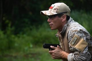 A Chilean comando aims at a target during a stress shoot as part of Fuerzas Comando