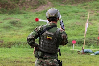 A shooter with team Colombia reloads his weapon to shoot his target