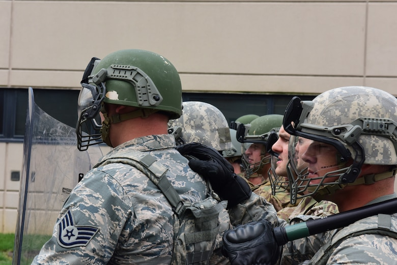 Security forces specialists from the 193rd Special Operations Security Forces Squadron, Middletown, Pennsylvania, Pennsylvania Air National Guard, conduct riot control countermeasures training July 22, 2018. The 193rd SOSFS Airmen participate in this two times a year as part of their required domestic operations training. (U.S. Air National Guard photo by Senior Airman Rachel Loftis/Released)
