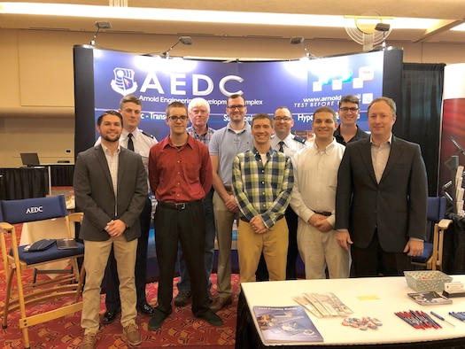 AEDC engineers represent Air Force Materiel Command at the 2018 National Space and Missiles Materiel Symposium held June 25-29 in Madison, Wisconsin. During the weeklong conference, several members of the AEDC team presented papers on the research and development occurring within the Space and Missiles Combined Test Force at Arnold Air Force Base. Pictured left to right: Benjamin Dolmovich, 1st Lt. Thomas Julian, Harry Clark, Bryan Sinkovec, Scott Williams, Jonathan Kodman, 1st Lt. Ryan Boudreaux, Nathan Tendick, Jon Rylan Cox and Edward Marshall Polk. Not pictured is Joseph Sheeley. (U.S. Air Force photo/Christopher Warner)
