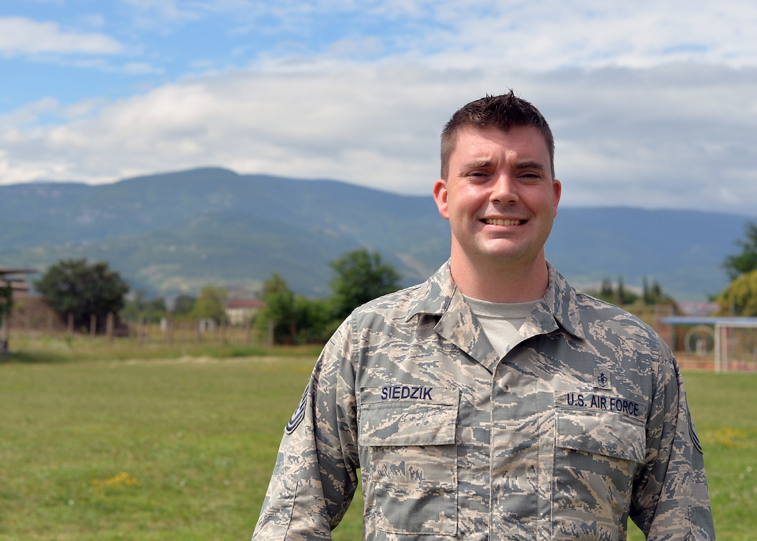 U.S. Air Force Tech. Sgt. Michael Siedzik, 37th Airlift Squadron independent duty medical technician, poses for a photo in Plovdiv, Bulgaria, July 19, 2018. Siedzik deployed with the 37th AS for Thracian Summer 2018, a bilateral exercise between the U.S. and Bulgaria. During the exercise, Siedzik provided medical care for deployed personnel to maintain health and wellness for members to safely and efficiently accomplish their objectives. (U.S. Air Force photo by Staff Sgt. Jimmie D. Pike)