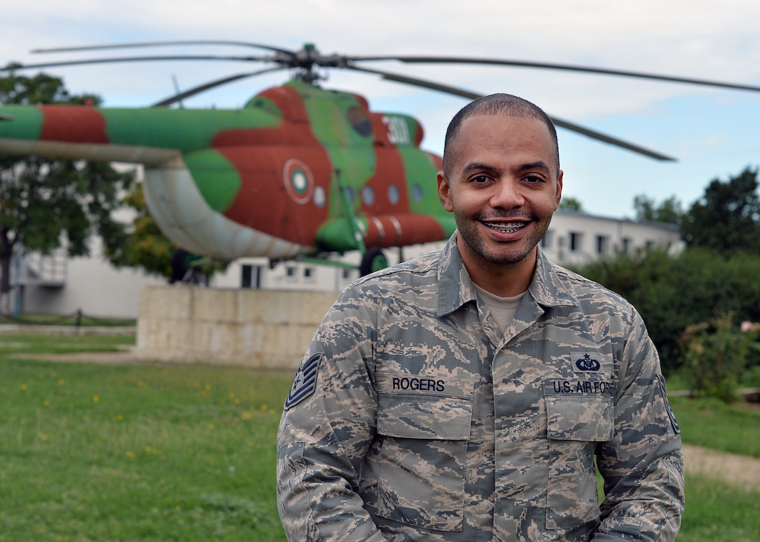 U.S. Air Force Tech. Sgt. Julius Rogers, 86th Operations Support Squadron aviation resource manager, poses for a photo in Plovdiv, Bulgaria, July 19, 2018. Rogers deployed with the 37th Airlift Squadron to support Thracian Summer 18, a bilateral exercise between the U.S. and Bulgaria. While deployed, Rogers ensured that aircrew members were fit to fly, and tracked their flight and training hours. (U.S. Air Force photo by Staff Sgt. Jimmie D. Pike)