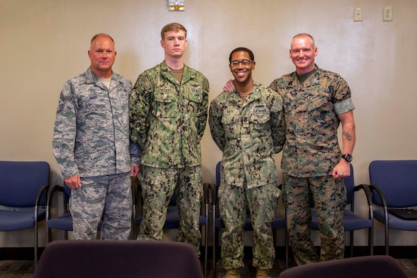 Marine Sgt. Maj. Paul McKenna, Command Senior Enlisted Leader, North American Aerospace Defense Command (NORAD) and United States Northern Command (NORTHCOM) and CMSgt James Brown, Command Senior Enlisted Leader, Joint Task Force Civil Support (JTF-CS), posed with newly promoted Logistics Specialist 1st Class Vincent Smith and Hospital Corpsman 2nd Class Casey Becker July 13 for a group photo. McKenna visited JTF-CS for a tour of the headquarters of the nation's only standing chemical, biological, radiological or nuclear response force. When directed, JTF-CS is ready to respond in 24 hours to provide command and control of 5,200 federal military forces located at more than 36 locations throughout the nation acting in support of civil authority response operations to save lives, prevent further injury, and provide critical support to enable community recover. (Official DoD photo by Mass Communication Specialist 3rd Class Michael Redd/released)
