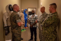 Marine Sgt. Maj. Paul McKenna, Command Senior Enlisted Leader, North American Aerospace Defense Command (NORAD) and United States Northern Command (NORTHCOM), is briefed by members of Joint Task Force Civil Support (JTF-CS) July 13 on the command's chemical, biological, radiological and nuclear (CBRN) equipment. McKenna visited JTF-CS for a tour of the headquarters of the nation's only standing chemical, biological, radiological or nuclear response force. When directed, JTF-CS is ready to respond in 24 hours to provide command and control of 5,200 federal military forces located at more than 36 locations throughout the nation acting in support of civil authority response operations to save lives, prevent further injury, and provide critical support to enable community recover. (Official DoD photo by Mass Communication Specialist 3rd Class Michael Redd/released)
