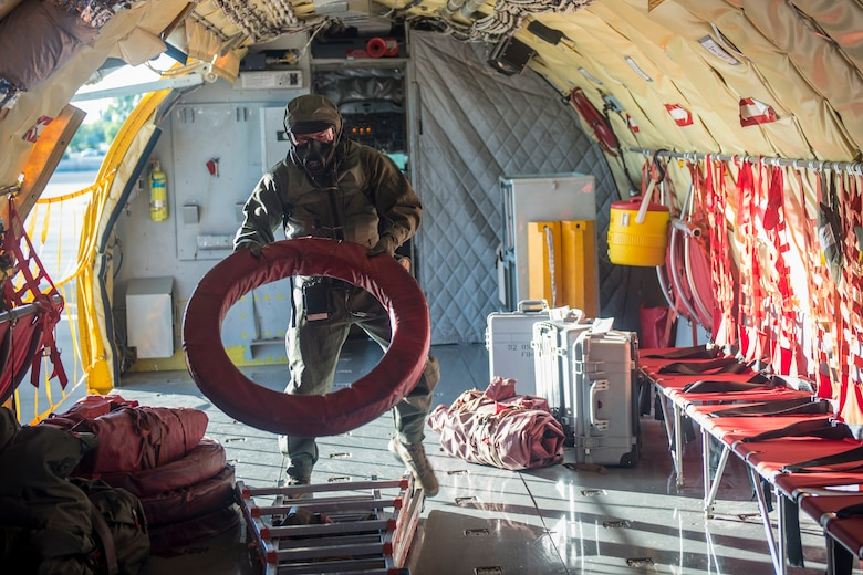 Senior Airman Stetson Vigil, 93rd Air Refueling Squadron boom operator, completes pre-flight tasks during the first in-field use and test of the new Joint Service Aircrew Mask on a KC-135 Stratotanker at Fairchild Air Force Base, Washington, July 17, 2018. The aircrew inspected crucial areas of improvement including comfort, weight, durability, heat stress, function and donning and doffing ease for every flight task. (U.S. Air Force photo/ Airman 1st Class Whitney Laine)