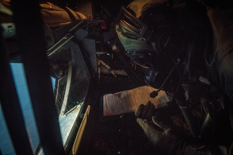 Airman 1st Class Jeremiah Guinto, 92nd Air Refueling Squadron boom operator, reviews a task checklist during the first in-field use and test of the new Joint Service Aircrew Mask on a KC-135 at Fairchild Air Force Base, Washington, July 17, 2018. The development of the JSAM contributes to the continuous investments in Mobility Air Force capabilities and readiness, which is essential to ensuring the Air Force maintains range, speed and agility advantages over potential adversaries, and in support of global mobility operations. (U.S. Air Force photo/ Airman 1st Class Whitney Laine)