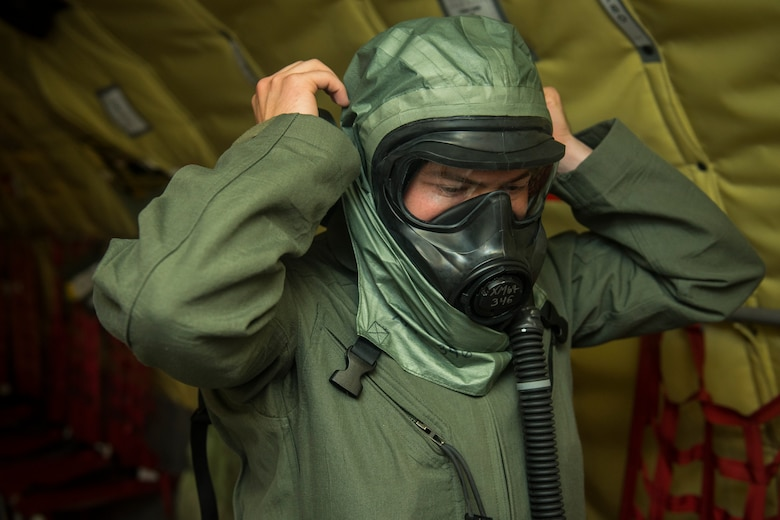 Senior Airman Stetson Vigil, 93rd Air Refueling Squadron boom operator, dons a new Joint Service Aircrew Mask at Fairchild Air Force Base, Washington, July 17, 2018, during the first KC-135 Stratotanker in-field use and test. The JSAM is a new chemical and biological defense mask/hood combination designed to replace former six-decades-old aircrew masks in the Department of Defense inventory. (U.S. Air Force photo/ Airman 1st Class Whitney Laine)
