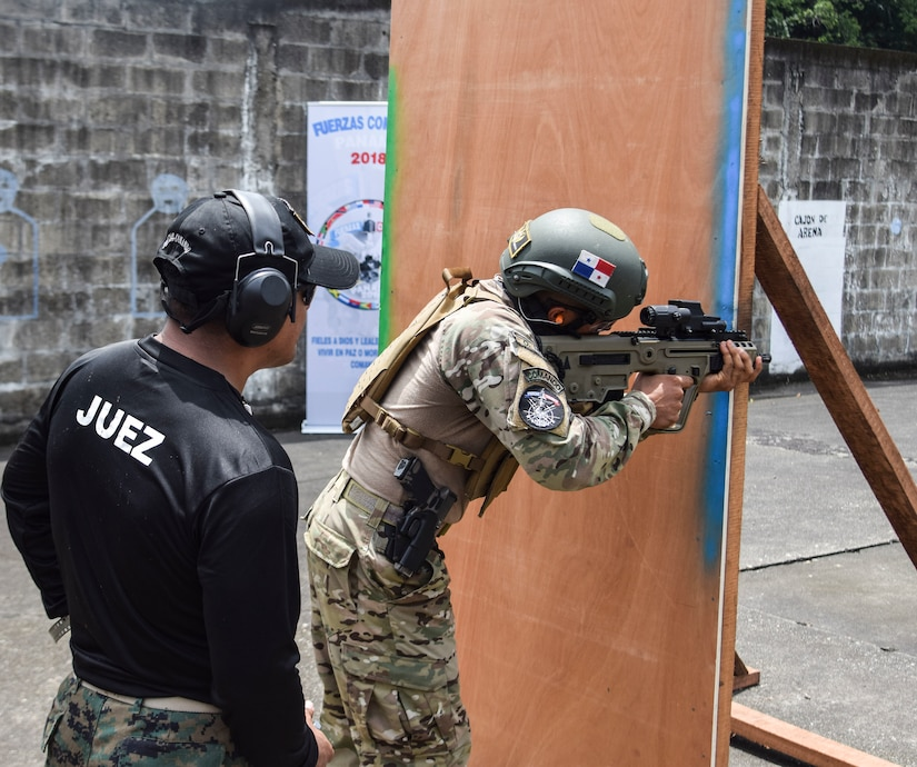 A Panamanian commando takes on an assault on a range during the Fuerzas Comando Competition at the Instituto Superior Policial, Panama, July 18, 2018. Army photo by Staff Sgt. Brian Ragin