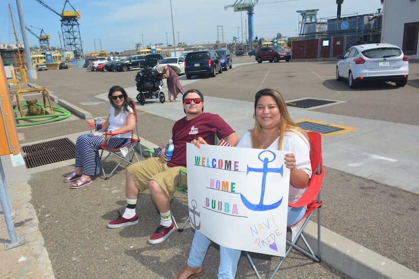 Family members await the return of the hospital ship USNS Mercy to San Diego following its five-month deployment to Southeast Asia in support of Pacific Partnership 2018, July 21, 2018. Navy photo by Sarah Burford