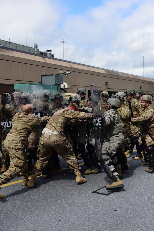 Security forces specialists from the 193rd Special Operations Security Forces Squadron, Middletown, Pennsylvania, Pennsylvania Air National Guard, conduct riot control countermeasures training July 22, 2018. The 193rd SOSFS Airmen participate in this two times a year as part of their required domestic operations training. (U.S. Air National Guard photo by Senior Airman Julia Sorber/Released)