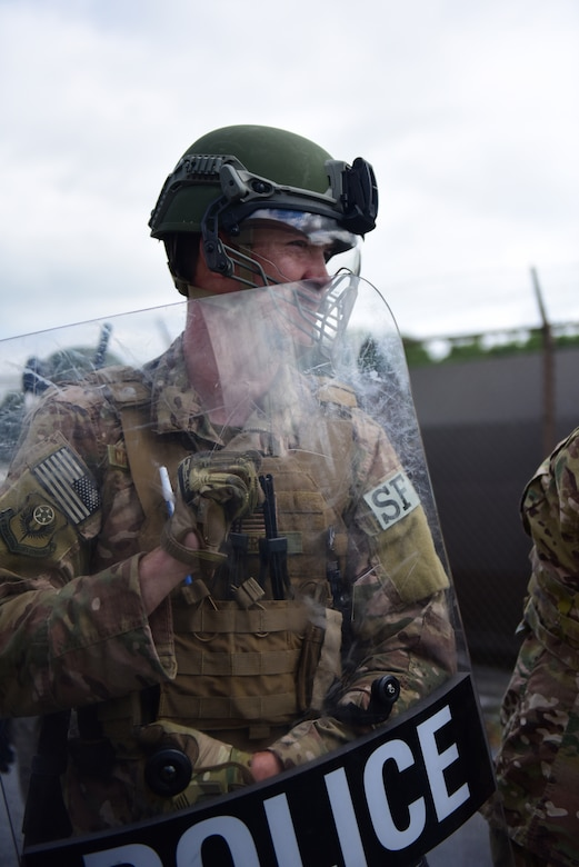 A security forces specialist from the 193rd Special Operations Security Forces Squadron, Middletown, Pennsylvania, Pennsylvania Air National Guard, conduct riot control countermeasures July 22, 2018. The 193rd SOSFS Airmen participate in this two times a year as part of their required domestic operations training. (U.S. Air National Guard photo by Senior Airman Julia Sorber/Released)