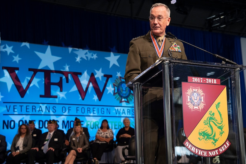Marine Corps Gen. Joe Dunford, chairman of the Joint Chiefs of Staff, addresses a crowd from a podium.