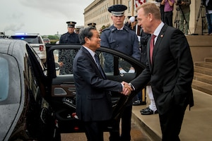 Deputy Defense Secretary Patrick M. Shanahan greets a visitor in front of the Pentagon.