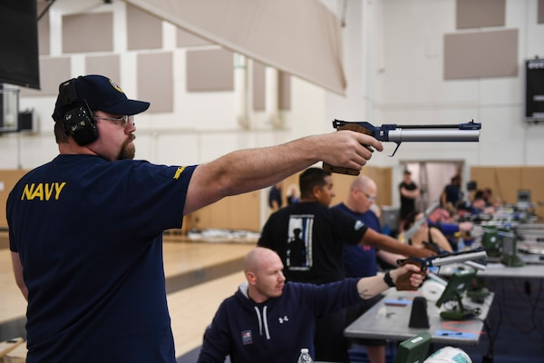Bill Longworth competes in the shooting portion of the Team Navy Trials at Naval Station (NAVSTA) Mayport's fitness center in preparation for the 2018 Department of Defense Warrior Games